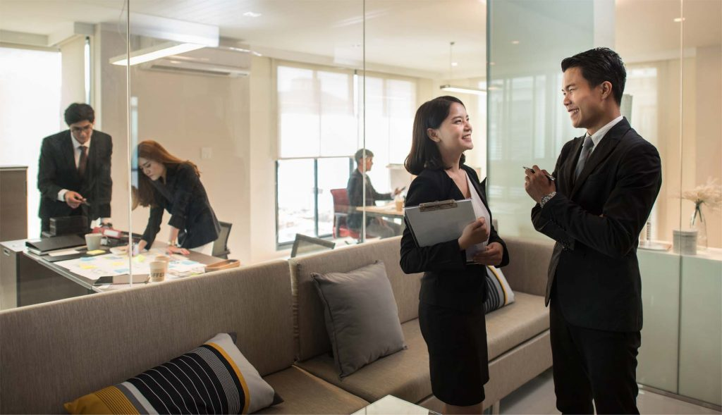 Business people in modern office. asian Businesswoman and businessman